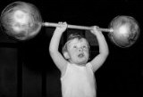 child lifting barbell